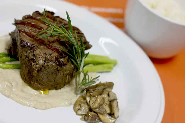 Grilled beef tenderloin with porcini cream sauce, funghi trifollati and rice pilaf