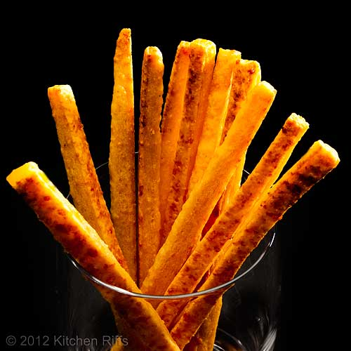 Cheese Straws in Glass, Black Background