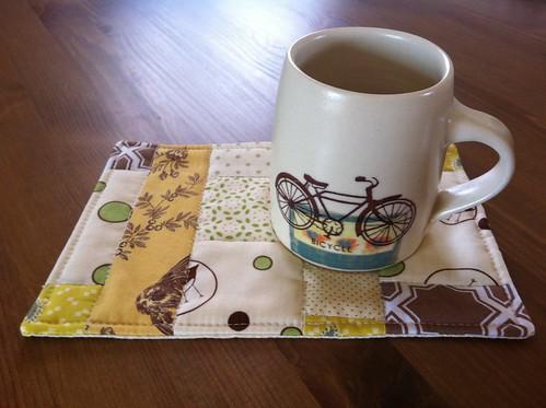Handmade mug rug and a Cathy Terepocki mug