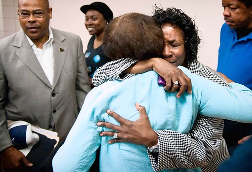Shirley Burns hugs a friend after Superior Court Judge Greg Weeks ruled Friday, April 20, 2012 that the trial of her son, Marcus Robinson, was so tainted by the racially influenced decisions of prosecutors that he should be removed from death row. by Pan-African News Wire File Photos