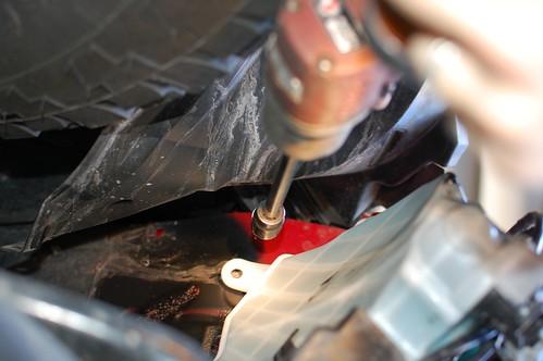 Removing upper bottle bolt