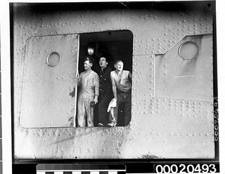 Three unidentified men possibly on board RMS QUEEN MARY near Port Jackson in Sydney, May 1940