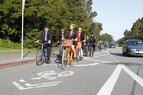 Leah Shahum and Mayor Ed Lee bike on the JFK Drive separated bikeway