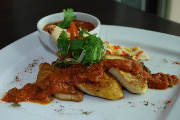 Bengali-style Shallow Fried Fish top Mouth Trickling Tawa Masala Sauce and Homemade Crispy Bell Pepper Naan