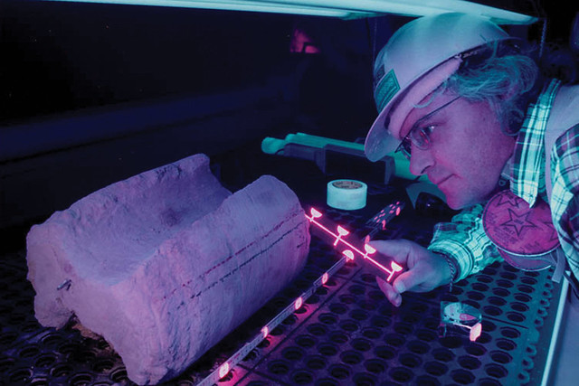 Former Los Alamos scientist Gilles Bussod uses ultraviolet light to study how fluids move throughrock. Such studies informed decisions about the Nevada site.