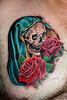 roses and skull tattoo by Mirek vel Stotker