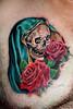 roses and skull tattoo by Mirek vel Stotker