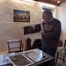 André découvre l'envoi de Toru Ukai.  A l'arrière, une sculpture de Daniel Fauville et une station essence de Jeep Novak, Galerie Ephémère, Thuin by andrefromont