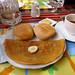Fabulous breakfast of fruit salad (I already ate it), crepe with jam inside, buns and tea :). Nasca, Peru 15APR12