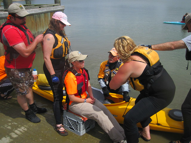 Virginia State Park Staff learn how to transfer a student with a mobility disability during the Adaptive Paddling Workshop. Staff L to R: Patrick Mcfall, Christen Miller, Megan France & Cameron Swain