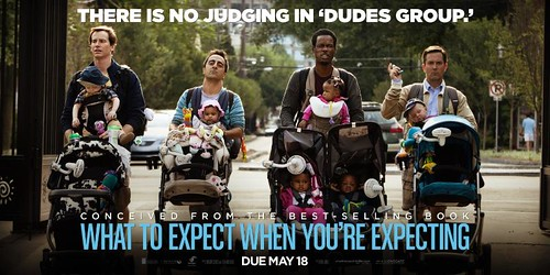 Dudes group movie poster shows four dads walking in the park with their babies in strollers in front of them.
