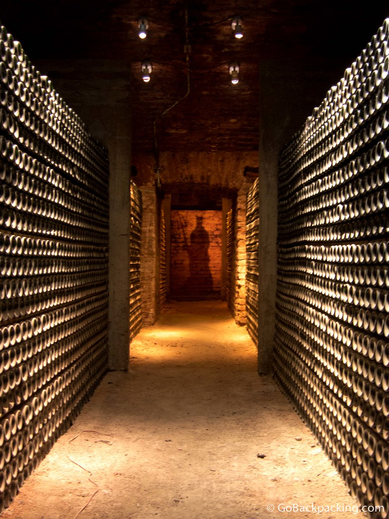 The shadowy figure of a devil stands at the end of this wine cellar in Casillero del Diablo