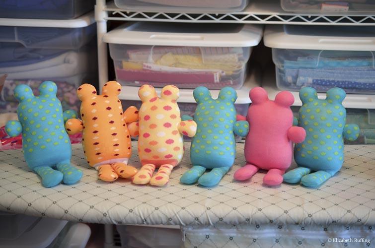 Assorted Hug Me Sock Toads, in progress, original art toys by Elizabeth Ruffing