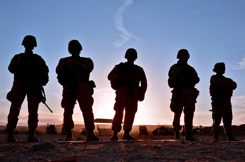 US Marines silhouetted against the sunset.  USDA's partnership with Operation Warfighter is just part of our commitment to helping veterans like Staff Sergeant Justin Fichter transition into civilian careers after their military service. Photo credit: US Marine Corps