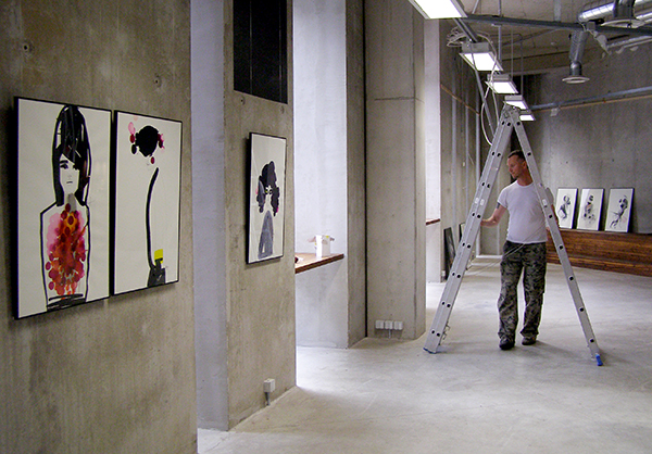 Curator Toomas Volkmann setting up New Nordic Fashion Illustration exhibition_Tallinn 2011