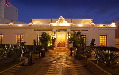 restaurant(0.0), palace(0.0), evening(0.0), estate(0.0), resort(0.0), home(0.0), building(1.0), hacienda(1.0), night(1.0), lighting(1.0),
