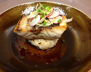 Bass, radish salad, ginger, grilled rice, charred onion broth