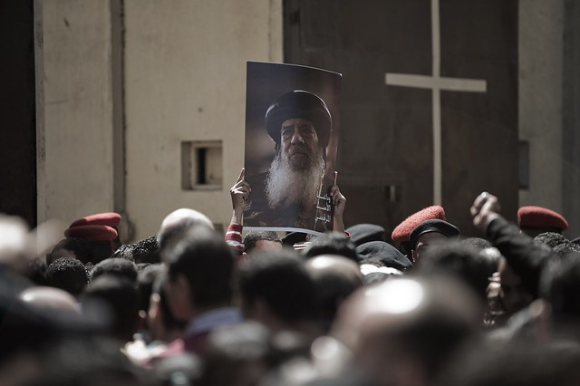 Mourners Hold a Photo of Pope Shenouda III