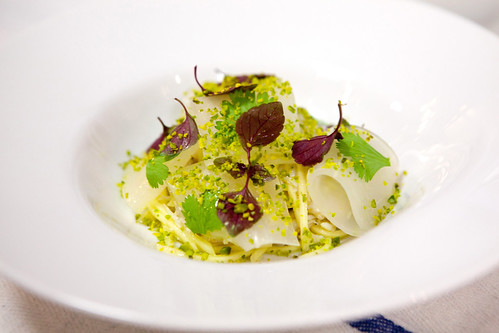 The plated Peekytoe Crab Salad with green mango, pickled daikon, toasted pistachio, pistachio with tarragon dressing