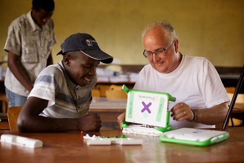 Kevin Gordon works with intern Simon Mwangangi to repair an XO