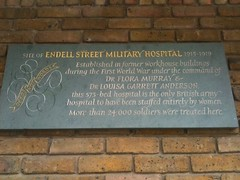 Photo of Flora Murray, Louisa Garrett Anderson, and Endell Street Military Hospital grey plaque