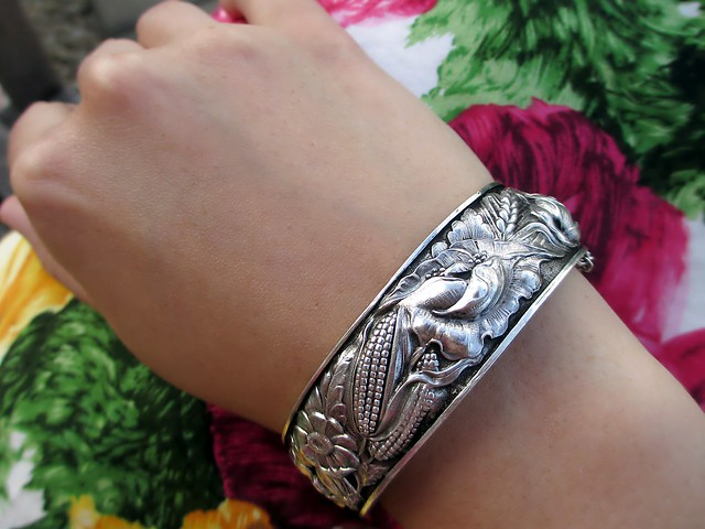 Art deco era silver bracelet featuring summer flowers, corn, and wheat.