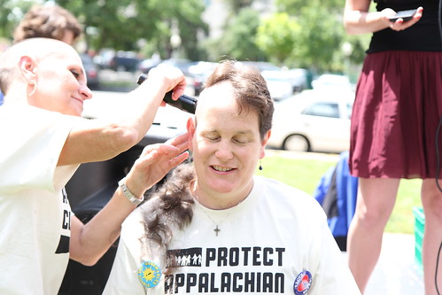 Shaving their heads in mourning and protest of the impacts of mountaintop removal.