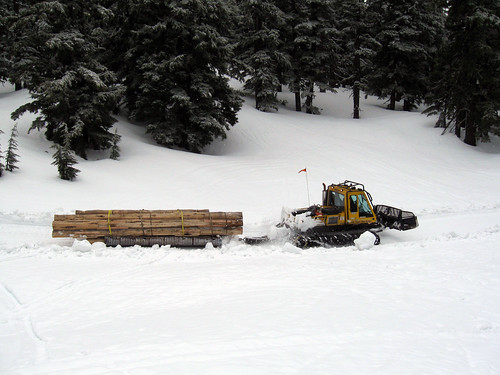 Employees and volunteers on the Deschutes National Forest devised an oversized sled from a discarded culvert on skis made from roadside guardrails to haul equipment to an elevation of 6,700 feet where they built a shelter. (US Forest Service photo)
