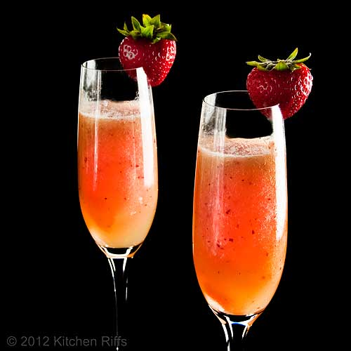 Bellini Cocktails with Strawberry Garnish, Black Background