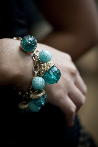 1960s charm bracelet with faceted turquoise baubles.