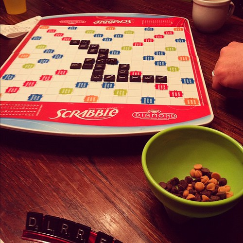 "Scrabble. Coffee. Chocolate and butterscotch chips. {I was desperate} The word ""fatten"" on the board. #irony #datenightathome"