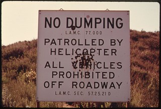 No dumping sign is a symptom of the population pressures along the coast of California off Mulholland Drive on the western edge of Los Angeles, May 1975