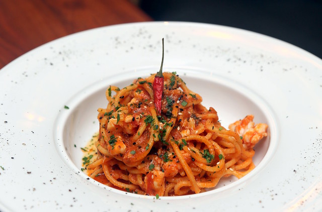 Capricci: Homemade spaghetti alla chitarra with lobster and tomato sauce