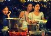 Shoppers in a night market, Phnom Penh, Cambodia, 2015