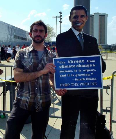 Danny Berchenko of 350.org-Ohio and fellow activists protest Keystone XL pipeline project during Obama's visit to Columbus Ohio on March 22, 2012