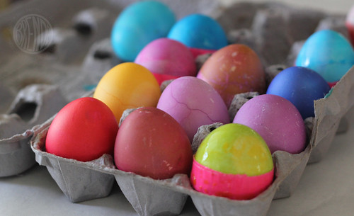 carton filled with colored eggs