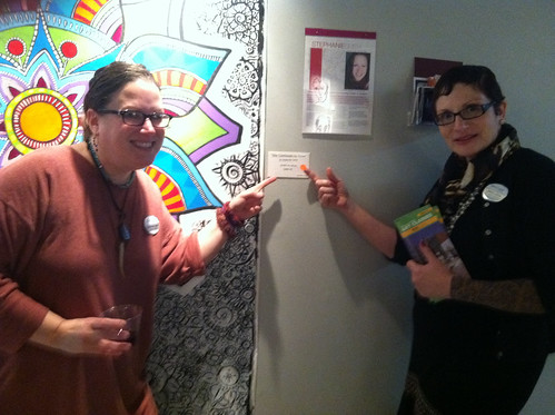 "Banana Factory Director Janice Lipzin placing the red ""sold"" sticker on my mural."