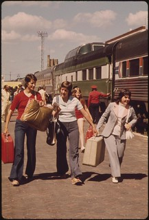Passengers at trackside at the Fargo, North Dakota, station Amtrak's Empire Builder, enroute from Chicago to East Glacier Park Montana, and Seattle, Washington, was seven hours late because of a bridge washout, June 1974