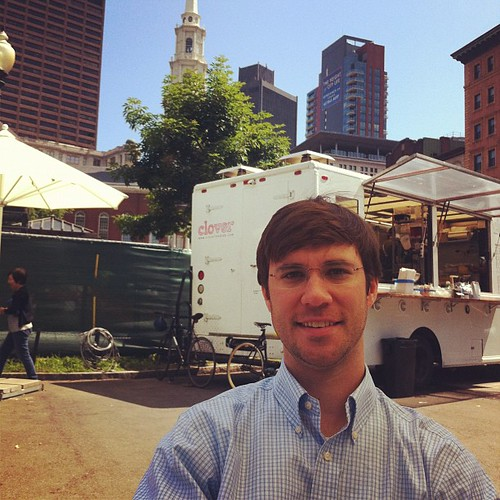 Enjoying a breakfast sandwich and coffee in the park after church (that's our church steeple behind the food vendor truck)