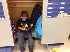 Child in locker using iPad