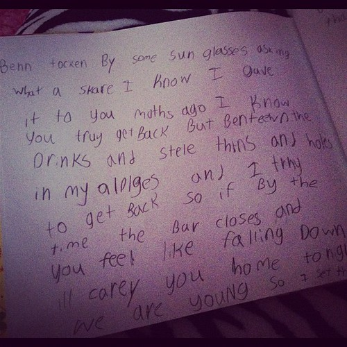 Found this in Karli's room...she is writing the words down to a song. guess which one?