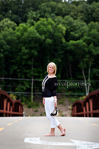 high school senior girl on bridge