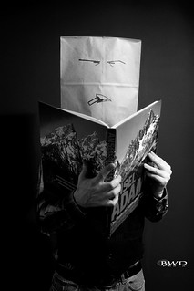 Paper Bag Man Reads Ansel Adams