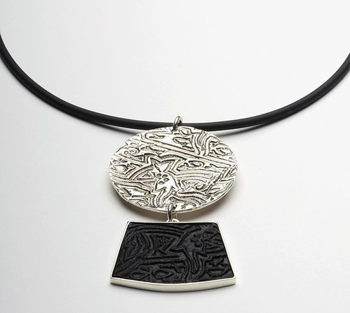 black pressed paper pulp and silver necklace