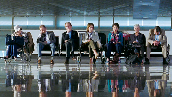 (L-R) Maggie Smith, Ronald Pickup, Bill Nighy, Penelope Wilton, Celia Imre, Judi Dench and Tom Wilkinson wait for transport to THE BEST EXOTIC MARIGOLD HOTEL.