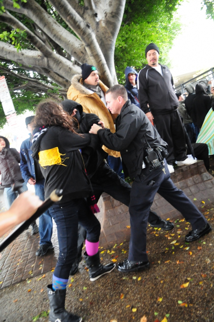 M17 OccupyLA Cop grabs man from behind