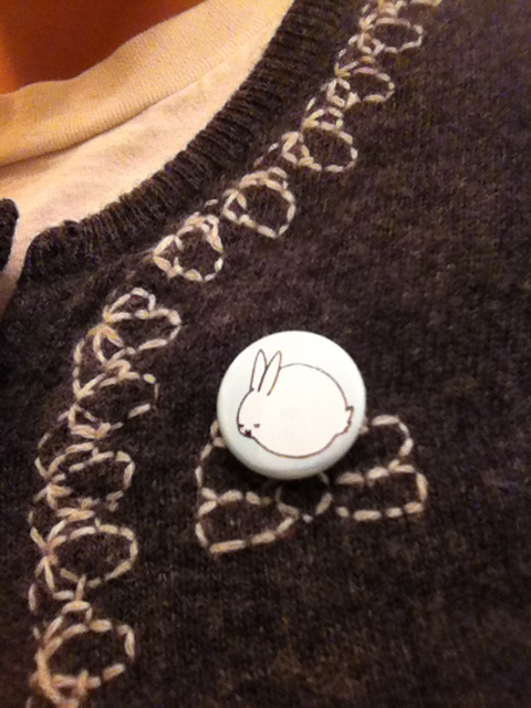 Sleeping Bunny one inch pinback button.