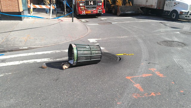 A manhole is smoking and giving off an electrical burning smell