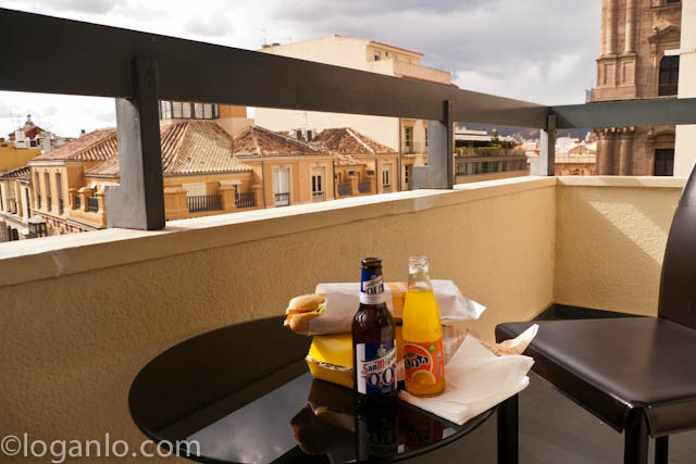 Food and drink on a balcony on the AC Hotel overlooking, Malaga, Spain