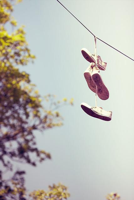 Hanging Sneakers by Matthew Dartford